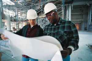 Contractors looking at a blueprint