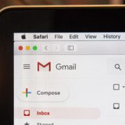 Gmail interface in corner of laptop screen