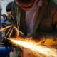 Man using metalworking equipment