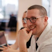 Man in glasses smiling in an office